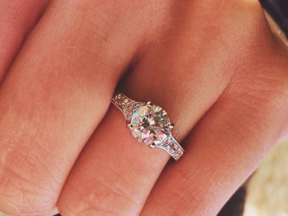 Round brilliant cut vintage engagement ring. Beauty!