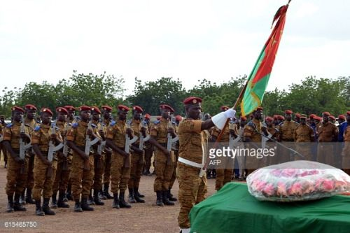 Burkinabe soldiers stand at attention during a military... #malilosinj: Burkinabe soldiers stand at attention during a… #malilosinj