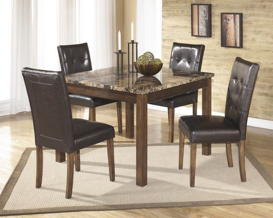 Whether the occasion is formal or casual, you are set to use this square table set for a dinner party or a simple breakfast with family. The faux marble top complements the warm brown of the clean line contemporary legs.