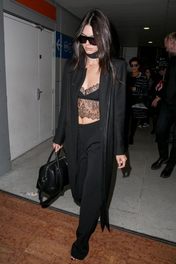Kendall Jenner arriving at Charles de Gaulle Airport on Sept. 29 wearing all-black and lace.:
