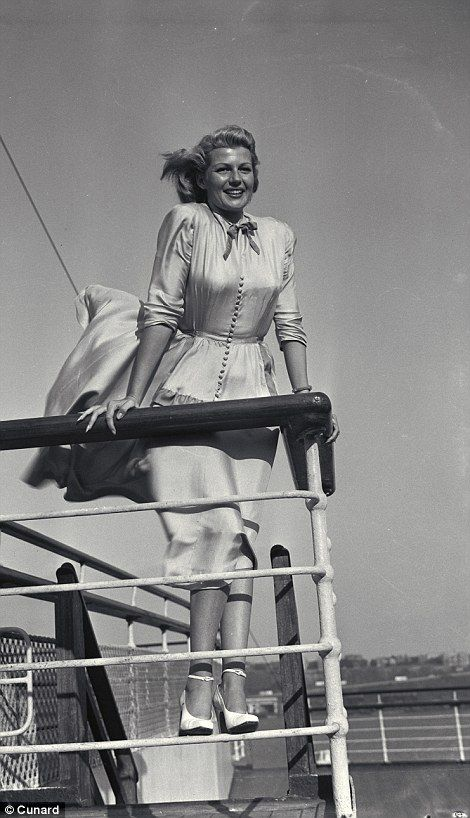 American actress Rita Hayworth strikes a pose while sunning on the top deck
