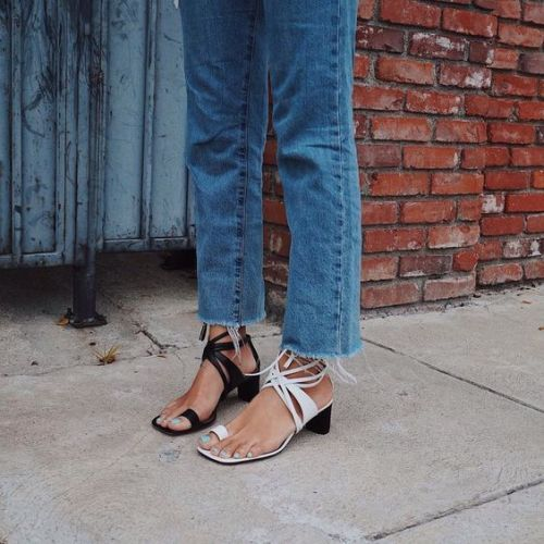 Mismatched strappy sandals in black and