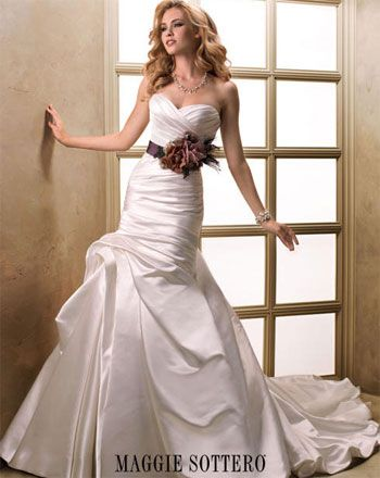 Floral Sash is a great way to add a pop of color to your wedding gown. Maggie Sottero sash available at @partydressexp