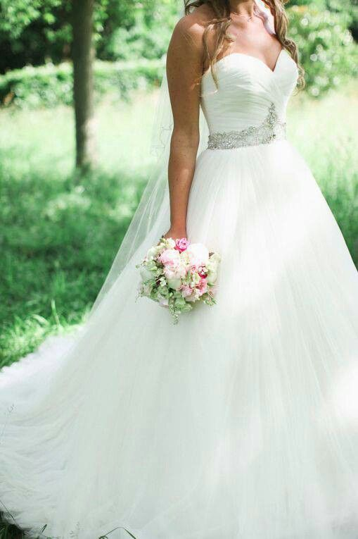 A princess dress with a bit volume in the skirt of the dress and the crystal detailing on the waistline a beautiful dress