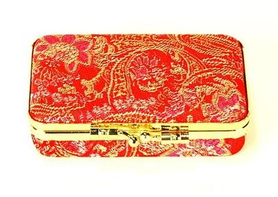What better way to organize earrings and other small trinkets than with this gorgeous silk brocade travel case, complete with a mirror in the inside.