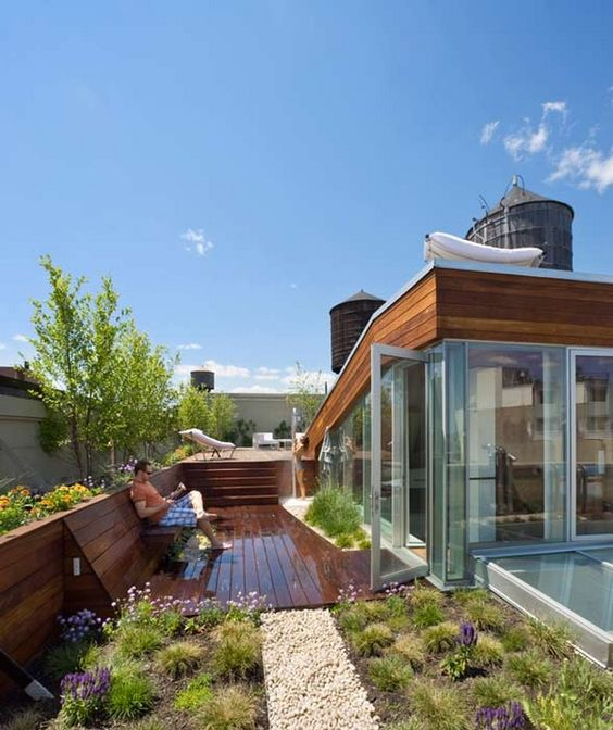 Photos this gorgeous green roofed noho penthouse is for for Decking terrace garden