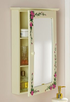 "Pink Rose Floral Bathroom Medicine Wall Cabinet Item #: 25226 / $ $19.97 from Collections Etc. catalog.  Beautiful wall cabinet in eggshell white includes mirror & hand-painted pink roses. Opens for extra storage. Wood/glass. 11 1/2""L x 3 1/4""W x 17 1/2""H."