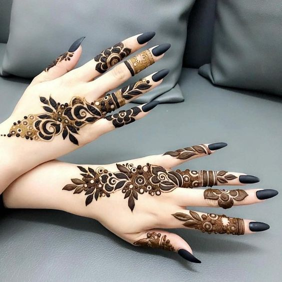 henna tattoo on hands and fingers black nails