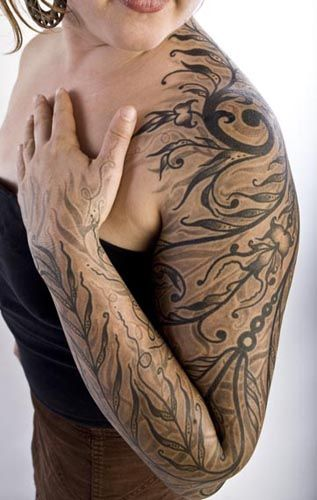 I love this black and grey, graphic, layered tattoo by Watson Atkinson