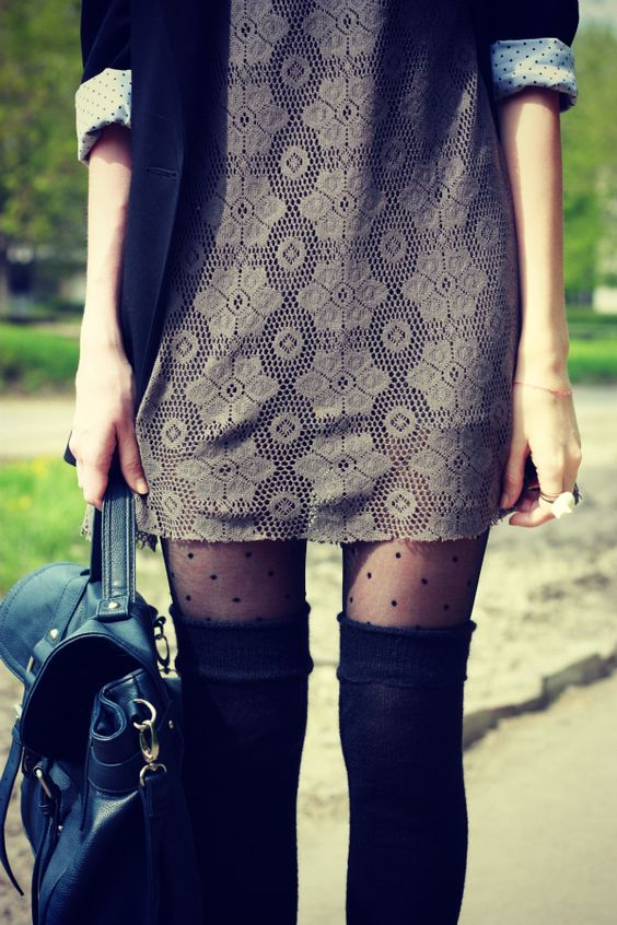 Black thigh high socks over polka dot tights and grey lace dress: