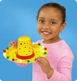 Cinco de Mayo craft - glue a cup to a plate, add some pom poms and decorate your sombrero: