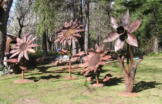 these giant rusty metal flower sculptures are wonderful