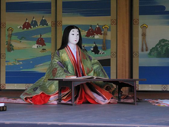 Kyoto Imperial Palace Mannequin: a Heian lady at writing practice. NOTE ~ style and height of table.