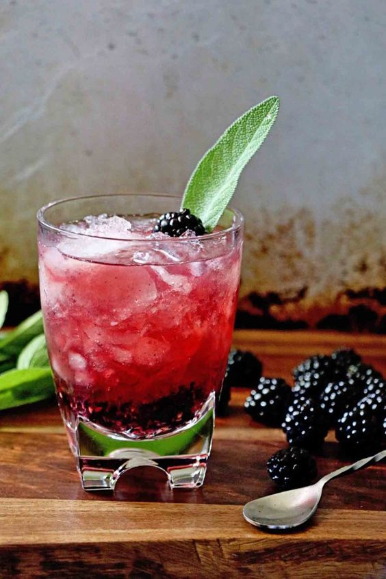 Add a bright pop of color to your New Year's Eve party with a signature Blackberry Sage Old Fashioned cocktail recipe! Your friends will be blown away by the presentation of this simple, delicious beverage.