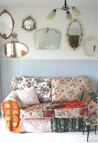 Granny chic living room, patchwork sofa, wall of mirrors
