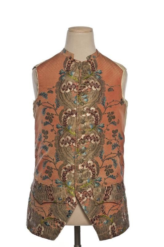 Waistcoat, France, 1760-1770. Salmon silk taffeta richly embroidered with large stylised flowers and leaves in coloured silk and metal threads of several textures.