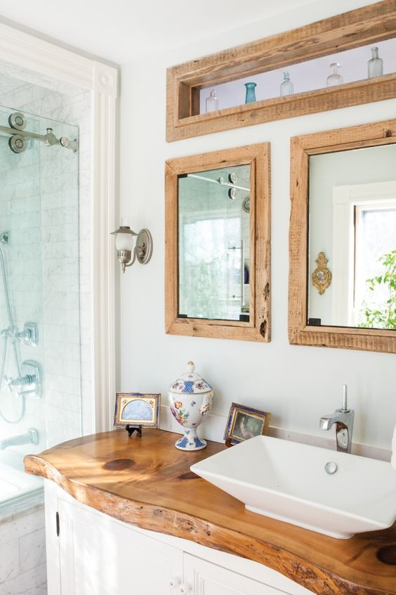In the owners' bath, a large slab of pine works as a countertop.