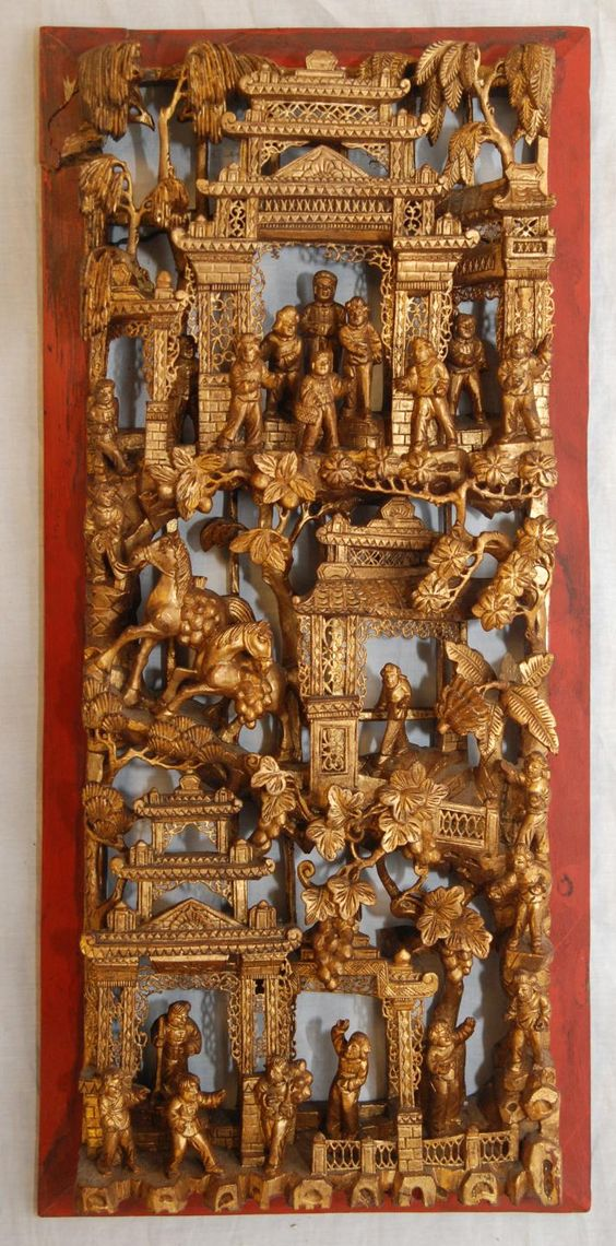 "Chinese fully reticulated gilt wood carving depicting a busy village scene with people, trees, pagodas, rock formations, flowers, leaves and horses. Measures 21 3/4"" height x 10 1/8"" width x 2 1/2"" depth (55.2cm x 25.7cm x 6.3cm). Total weight of 1.46 kilograms. Provenance: Sam Feldman Collection."