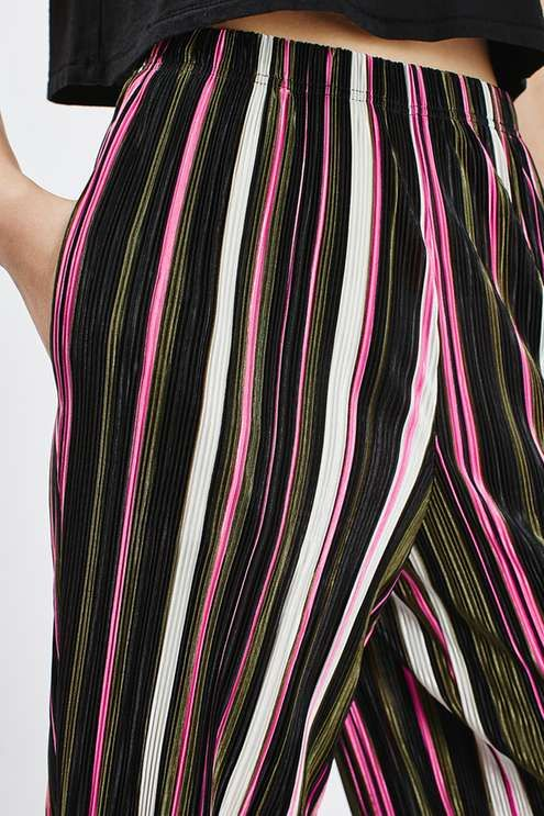 Mix up your wardrobe with these pleated trousers, in an edgy shorter length with multi-coloured stripe detail. Style with leather heels and a crop top for a model-girl going out look. #Topshop