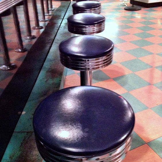 Beautiful retro soda shop stools at Peggy Sue's Diner. On the way to Vegas Baby with a quick stop for apple pie and a Coke float yum #soda #sodajerk #sodalirious #localbusiness #sandiego #homemadesoda #craftsoda #peggysuesdiner