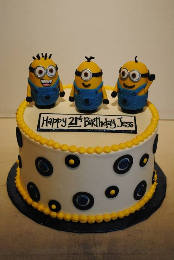 Minion party. Round buttercream cake with rice krispies minions.