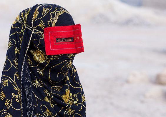 a bandari woman wearing a traditional mask called the burqa, Qeshm Island, Salakh, Iran: