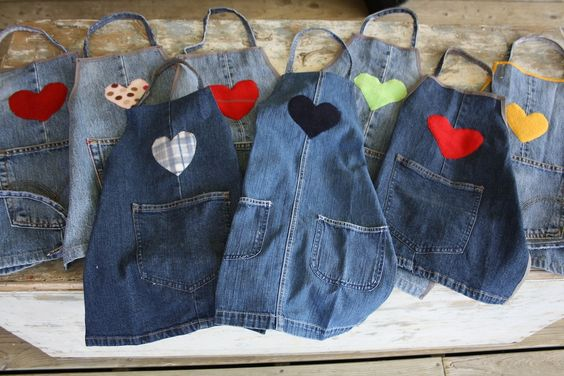 re-purposed denim aprons -love this idea and since boys do art projects too I thought a dinosaur or super hero logo for the front and the neck strap could be the metal clip side from coveralls.