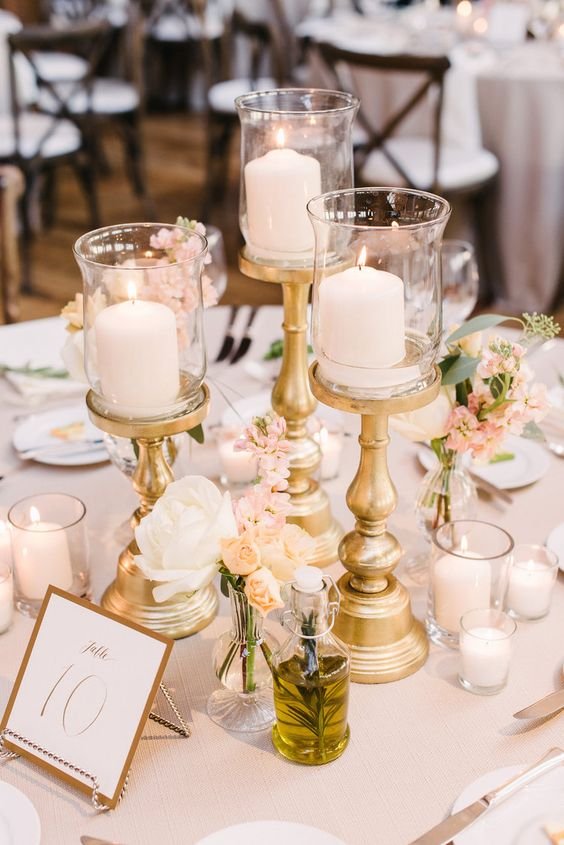 Elegant golden wedding decor centerpieces table candlesticks || Chicago wedding flowers styling and decor from Fleur, Inc -> view profile in link: