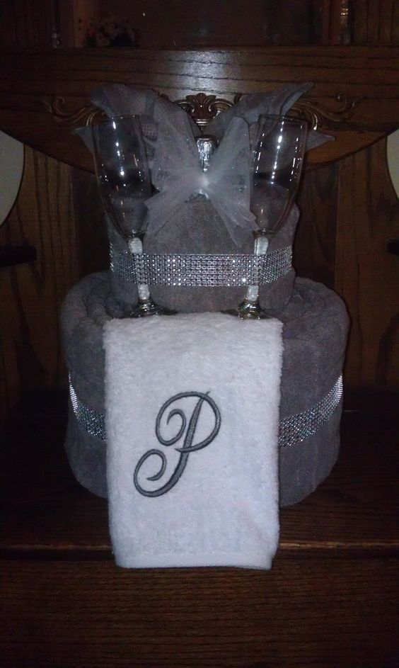 Great shower gift!  Towel cake with champagne and glasses.