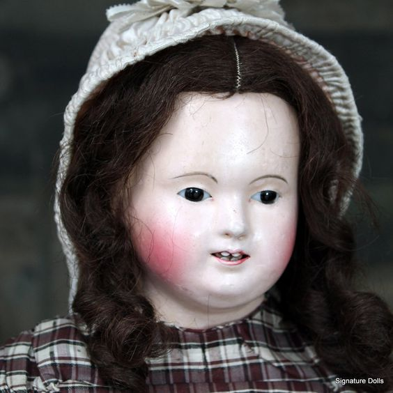 """A superb early circa 1840 wigged Papier-Mache doll by Andreas Voit in all-original condition. At 24"""" tall, the doll is complete with original hair wig, original plaid silk costume, original undergarments, fabulous complexion and  wonderful early red leather boots These early dolls were made for the French market and are found on pink kid leather bodies"""