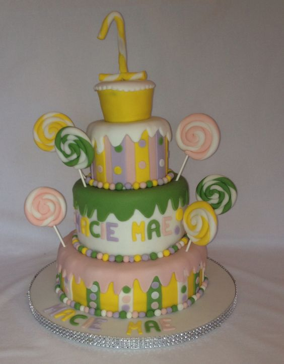 A colourful elaborate first birthday cake