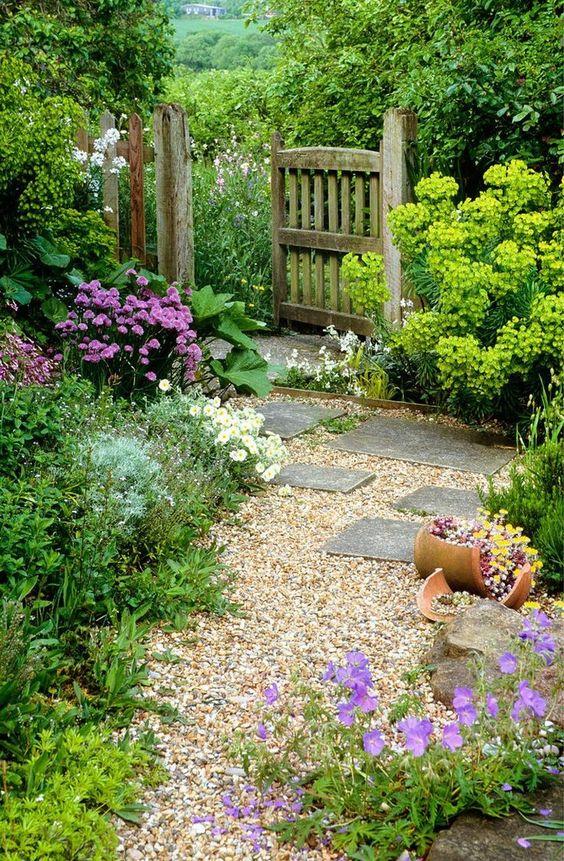 Winding gravel path through a cottage garden
