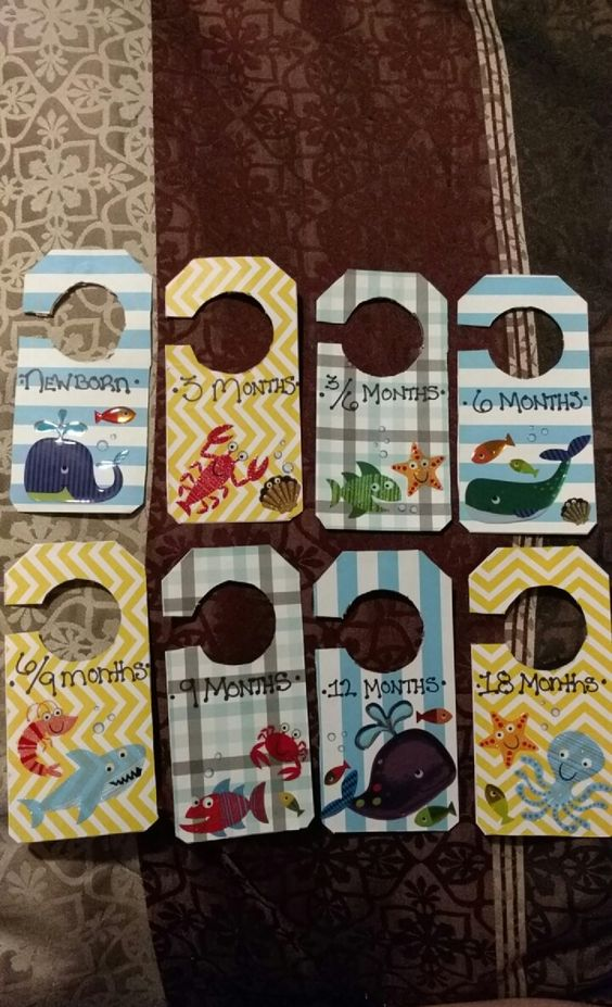 Baby clothes dividers on a budget! Card stock paper, card stock tags, stickers, sharpie, glue and scissors. All from Michaels for $15!