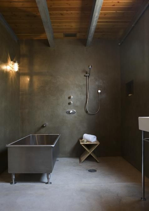 An industrial chic bath by Texas-based architect Mel Lawrence.