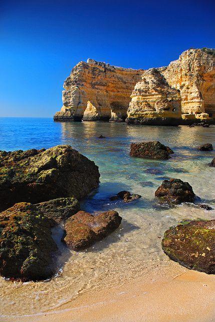 Algarve, Portugal. I can't wait to go back... Marinha morning by Juampiter, via Flickr