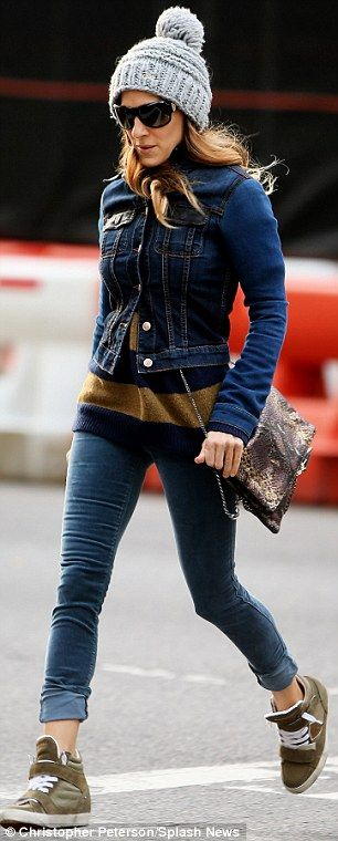 Time to go: The 48-year-old actress wore a jean jacket, gold and blue sweater, skinny jeans, new gold kicks, and a flashy snakeskin-patterne...