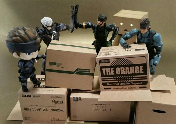 Metal Gear action figures and their boxes.
