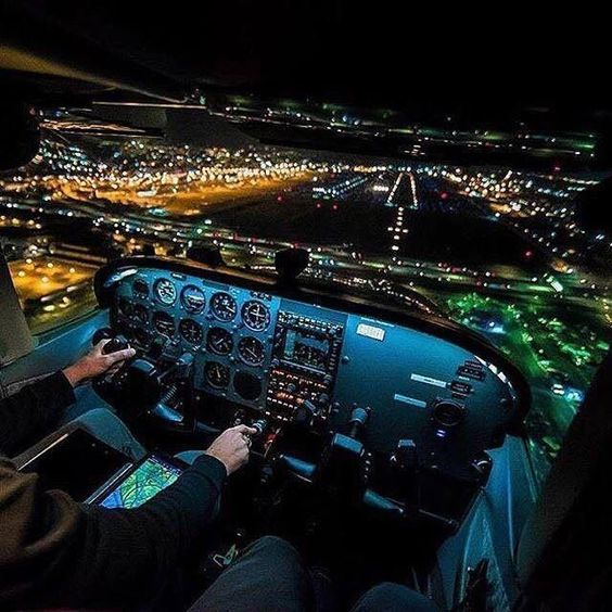 Cockpit View From A Small Plane At Night On Landing Approach
