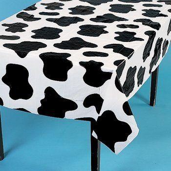 Cow Spots Table Cover by SmallToys, http://www.amazon.com/gp/product/B003SRI4CS/ref=cm_sw_r_pi_alp_gxL6pb0S82MPV