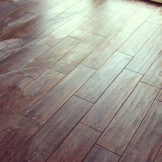porcelain wood tile: Marazzi Montagna tiles from Home Depot in u201cGunstock.u201d