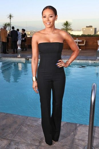 Melanie Brown Mel B. attends the Los Angeles Confidential celebration of the Women of Influence issue with Robin Wright in Beverly Hills, California.