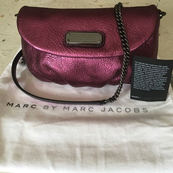 """🌺SALE🌺 NWT Metallic Leather Marc Jacobs Bag Just added some new pics so you can really see how gorgeous this bag is!!!  New with tags never used Marc by Marc Jacobs Karlie Q crossbody bag.  Gorgeous metallic pink-purple leather, color called """"wine"""".  Black metal hardware including logo plate on the front.  Removable leather and chain strap, also works as a clutch.  Great size for a night out: holds keys, phone and has interior card pockets as well.  Dustbag not included. Marc by Marc…"""