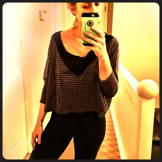 Free people crop sweater- light weight! Cropped Free People sweater with 3/4 sleeves and black and gray stripes. NWOT, never worn, mint condition. Very lightweight and perfect for layering and warmer temps! Free People Tops Crop Tops