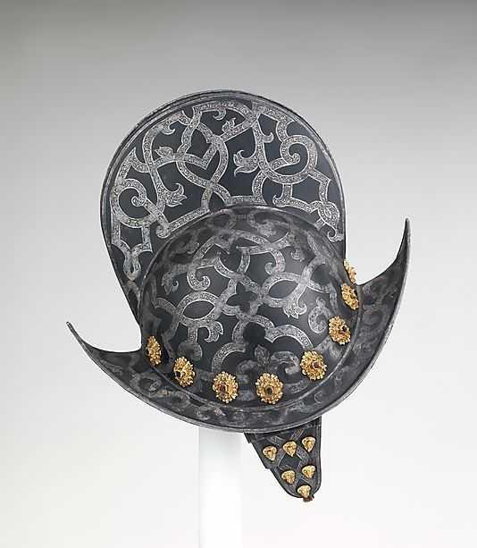 Morion Date: late 16th century Culture: German, Nuremberg Medium: Steel, etched, silvered, and painted; gilt brass; glass Dimensions: Weight, 4 lb. 11 oz. (2126 g) Height, 12 9/16 in. (31.9 cm) Greatest width, 8 15/16 in. (22.68 cm) Classification: Helmets Credit Line: Gift of William H. Riggs, 1913 Accession Number: 14.25.650