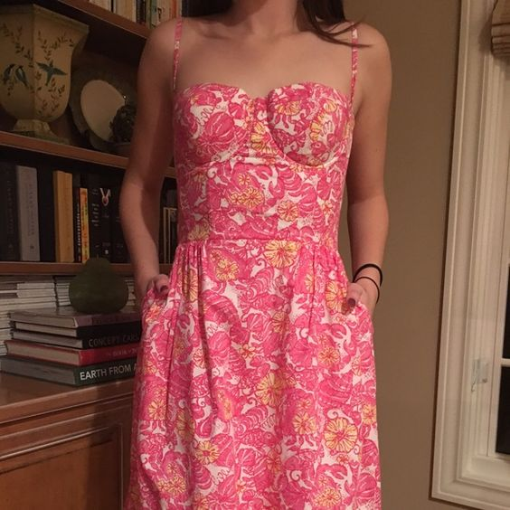 Lilly Pulitzer dress This dress has only been worn one time.  It has adjustable straps and a bra-like top so no need to wear a bra with this! Lilly Pulitzer Dresses Mini