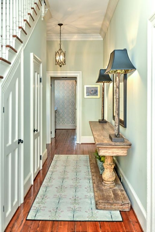 Traditional Hallway with Chandelier, Crown molding, Carpet, LARGE RUSTIC PINE CONSOLE TABLE, Brass Pineapple Candlestick Lamp