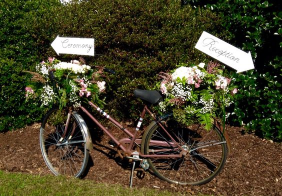 Antique Bicycle with fresh florals and direction signs for your special event ...rent yours @ Flowers by Tammy