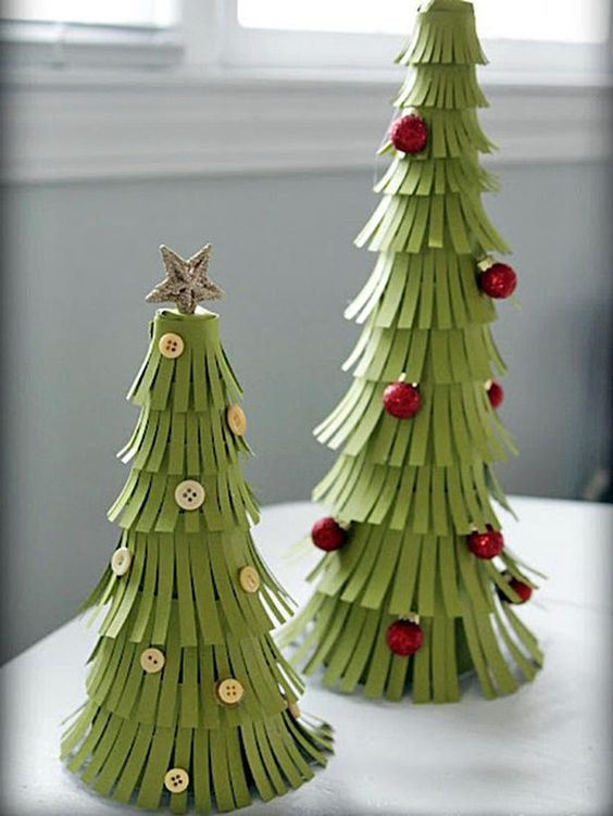 This adorable handmade holiday craft takes less than an hour -- and costs under $20.  http://www.hgtv.com/handmade/pretty-paper-christmas-trees/index.html?soc=pinterest: Christmas Decoration, Christmas Idea