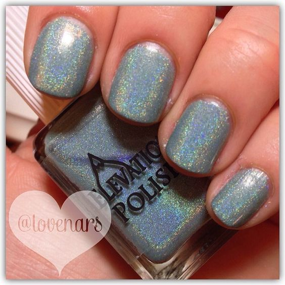 Elevation Polish Charity SBP October 2013 - Name: Glacier Glare - Description: Soft Teal holographic (near linear in holographic) Uses 4 different grades and/or types of holographic pigment Finish: Holographic Inspiration: the light bouncing off a glacier