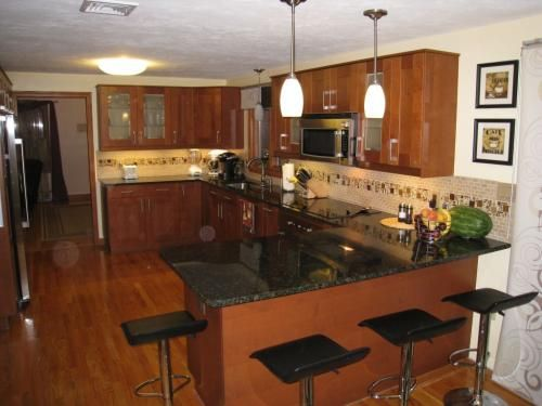Best Adel Medium Brown Cabinets Ikea And Black Countertops And 640 x 480